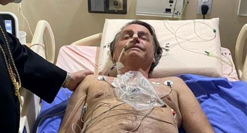 This handout photo obtained from the twitter account of Brazil's President Jair Bolsonaro (@jairbolsonaro), shows Brazil's President Jair Bolsonaro on his hospital bed in Brasilia on July 14, 2021. - Brazil President Jair Bolsonaro was admitted to hospital on Wednesday to investigate the cause of persistent hiccups, the government said.