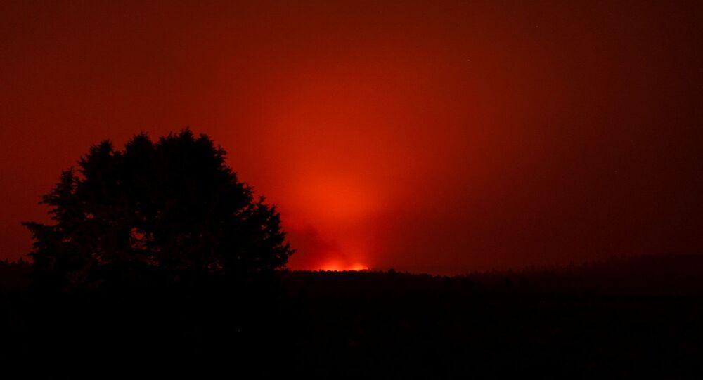The Bootleg Fire glows in the distance, near Beatty, Oregon, U.S., July 13, 2021.