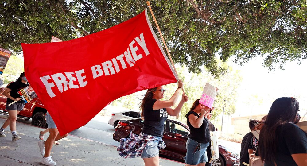 Protesters attend a #FreeBritney Rally at Stanley Mosk Courthouse on July 14, 2021 in Los Angeles, California. The group is calling for an end to the 13-year conservatorship lead by the pop star's father, Jamie Spears and Jodi Montgomery, who have control over her finances and business dealings. Planned co-conservator Bessemer Trust is petitioning the court to resign from its position after Britney Spears spoke out in court about the conservatorship.