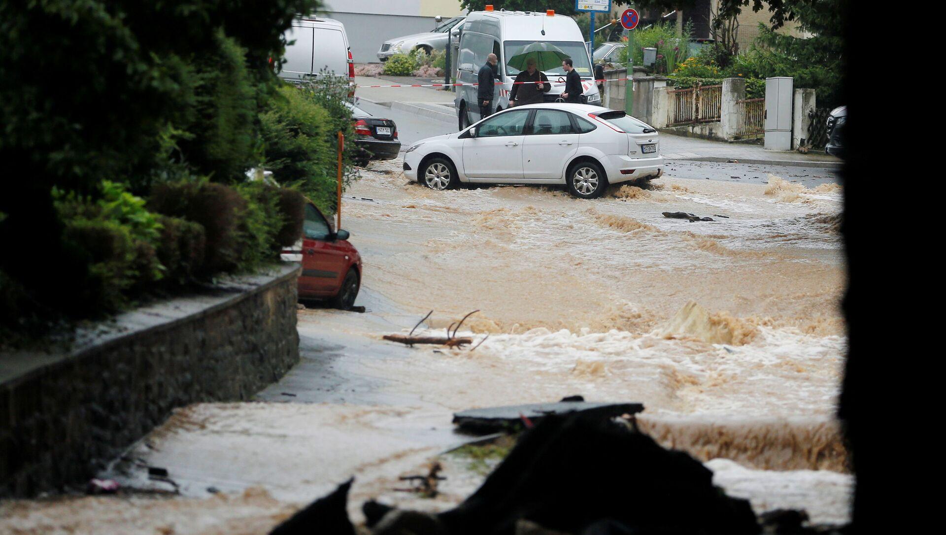 A flooded street is seen following heavy rainfalls in Hagen, Germany, July 14, 2021.   REUTERS/Leon Kuegeler - Sputnik International, 1920, 15.07.2021