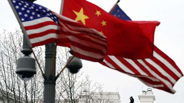 (FILES) In this file photo taken on January 17, 2011, a Secret Service agent guards his post on the roof of the White House as a lamp post is adorned with Chinese and US national flags in Washington, DC - Sputnik International