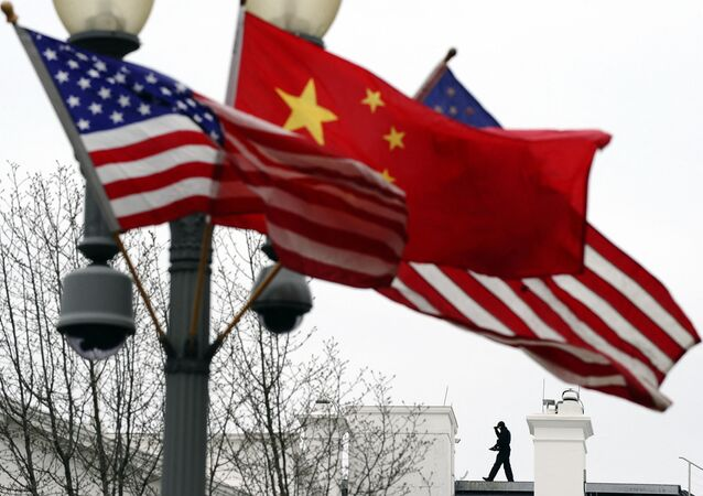 (FILES) In this file photo taken on January 17, 2011, a Secret Service agent guards his post on the roof of the White House as a lamp post is adorned with Chinese and US national flags in Washington, DC