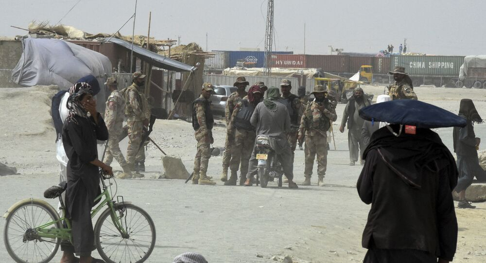 Pakistani troops patrol in the border town of Chaman on 14 July 2021, after the Taliban claimed they had captured the town of Spin Boldak on the Afghan side of the border crossing along the frontier with Pakistan.