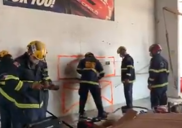 Woman wedged between two walls out.