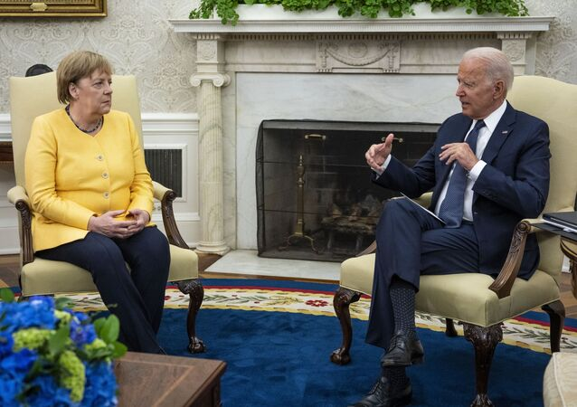 German Chancellor Angela Merkel (L) and U.S. President Joe Biden make brief remarks to the press before a meeting in the Oval Office at the White House on July 15, 2021 in Washington, DC. During what is likely her last official visit to Washington, the leaders are expected to discuss their shared priorities on climate change and defense; and Biden is expected to voice his concerns about the Nord Stream 2 Russian natural gas pipeline.