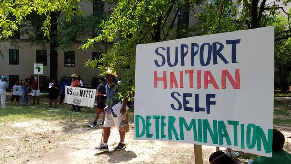 Activists rally outside the US State Department against US involvement in Haiti, including the potential deployment of US troops after the assassination of Haitian President Jovenel Moise - Sputnik International