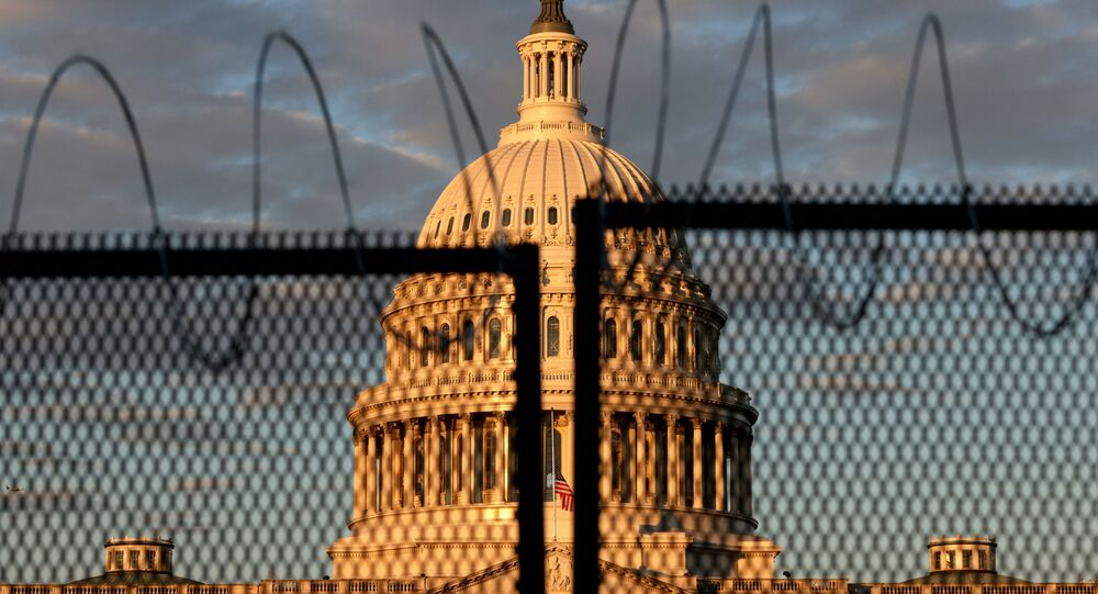 The U.S. Capitol is seen behind a fence with razor wire during sunrise on January 16, 2021 in Washington, DC. After last week's riots at the U.S. Capitol Building, the FBI has warned of additional threats in the nation's capital and in all 50 states. According to reports, as many as 25,000 National Guard soldiers will be guarding the city as preparations are made for the inauguration of Joe Biden as the 46th U.S. President.
