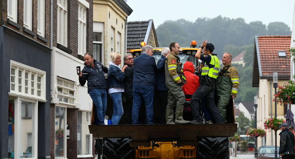 People are evacuated from a flood-affected area, following heavy rainfalls in Valkenburg, Netherlands, July 15, 2021.