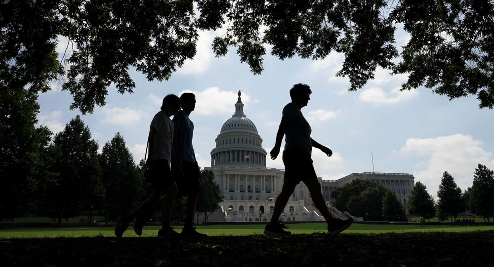Visitors walk the grounds of the U.S. Capitol, days after the removal of security fencing which was placed around the complex after the January 6th attack, in Washington, U.S., July 12, 2021.