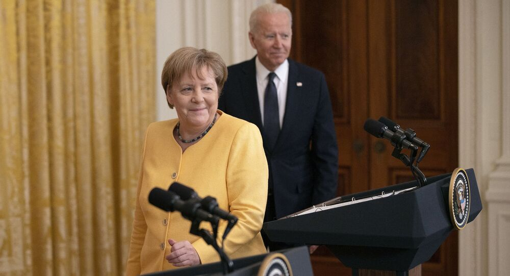 German Chancellor Angela Merkel (L) and U.S. President Joe Biden take the stage for a joint news conference in the East Room of the White House on July 15, 2021 in Washington, DC. During what is likely her last official visit to Washington, Merkel and Biden discussed their shared priorities on climate change and defense; and Biden voiced his concerns about the Nord Stream 2 Russian natural gas pipeline.