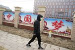 A man passes by the words China Dream outside the entrance to the Wuhan Institute of Virology during a visit by a World Health Organization team in Wuhan in China's Hubei province on Wednesday, Feb. 3, 2021