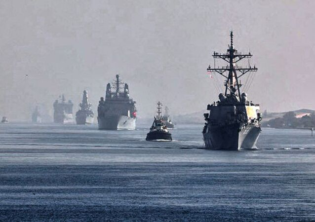 This handout image provided by the official Twitter account of Commodore Steve Moorhouse, Royal Navy, Commander of the UK Carrier Strike Group on July 6, 2021 shows a view of the vessels of the strike group sailing behind the Royal Navy's HMS Queen Elizabeth aircraft carrier through Egypt's Suez Canal.