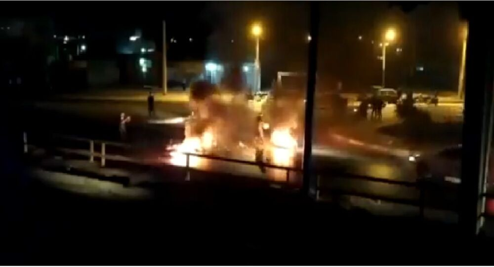 People burn tires in Iranian cities protesting against water shortages