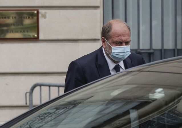 France's Justice Minister Eric Dupond-Moretti leaves the Court of Justice after questioning, in Paris, on July 16, 2021. - French Justice Minister Eric Dupond-Moretti was charged on July 16, 2021, in a conflict of interest inquiry after questioning by investigating magistrates, his lawyers said. Dupond-Moretti, 60, has been accused of taking advantage of his position as minister to settle scores with opponents from his legal career. He is France's first sitting justice minister to be charged in a legal probe.