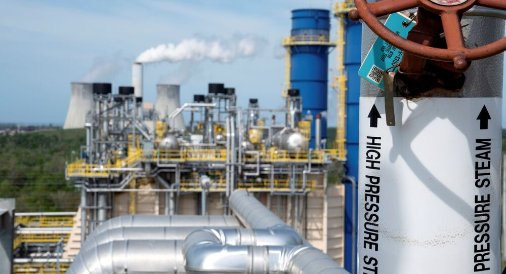 A coal-fired power plant operates in the background of the recently built gas-fired power plant at Duke Energy's Crystal River Energy Complex in Crystal River, Florida, U.S., March 26, 2021