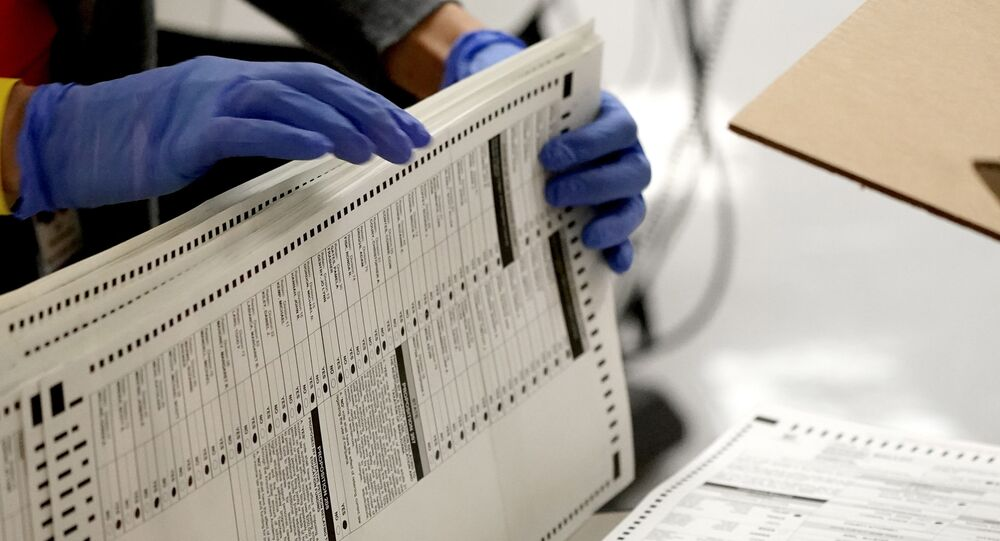 In this Nov. 4, 2020, file photo Maricopa County elections officials count ballots at the Maricopa County Recorder's Office in Phoenix. The Supreme Court has upheld voting restrictions in Arizona in a decision that could make it harder to challenge other voting measures put in place by Republican lawmakers following last year's elections.