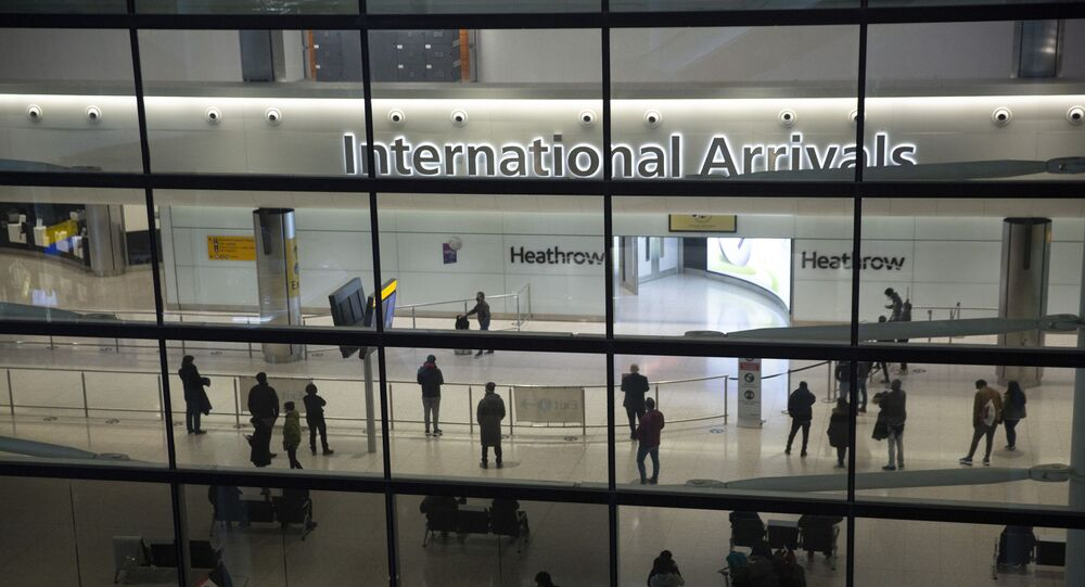 In this file photo dated Tuesday, 26 January 2021, people in the arrivals area at Heathrow Airport in London, during England's coronavirus lockdown