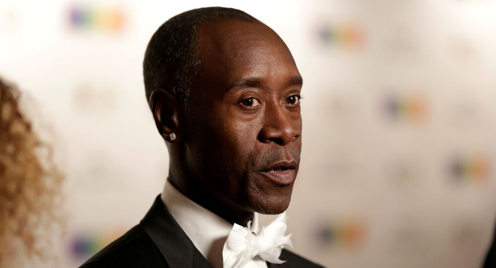 Actor Don Cheadle speaks to the media as he arrives for the Kennedy Center Honors in Washington, U.S.