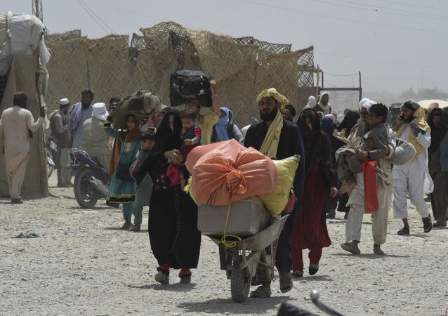 People walk towards a border crossing point in Pakistan's border town of Chaman on July 17, 2021, after Pakistan partially reopened its southern crossing with Afghanistan, shut off since the Taliban seized control of the strategic border town on the other side.