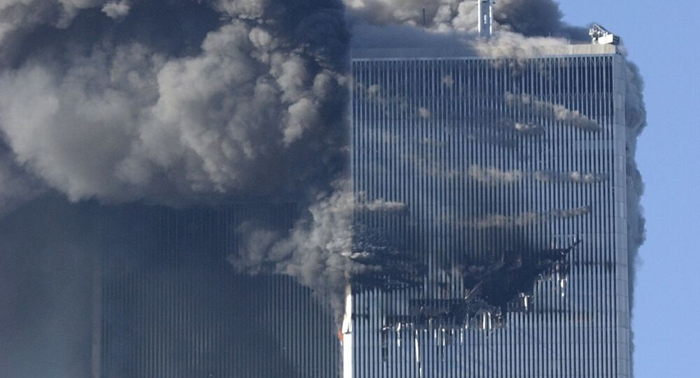 Smoke billows from the North and South Towers of the World Trade Center before they collapsed on September 11, 2001 in New York, NY