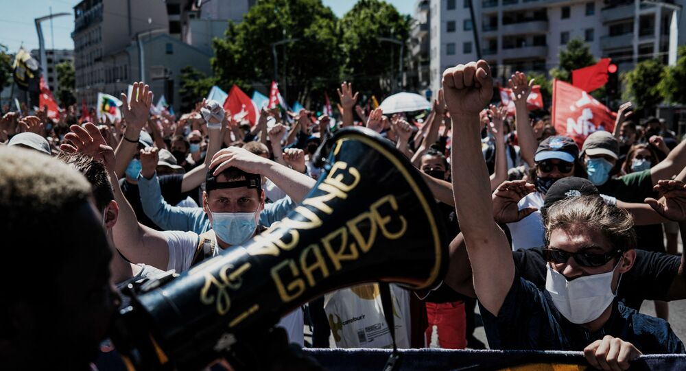 People take part in a Liberty March called against attacks on freedoms in Villeurbanne, near Lyon.