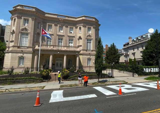 The message Cuba Libre or 'free Cuba', is seen painted in giant block lettering on the street directly in front of the Cuban embassy in this frame grab from video shot in Washington, U.S., July 16, 2021