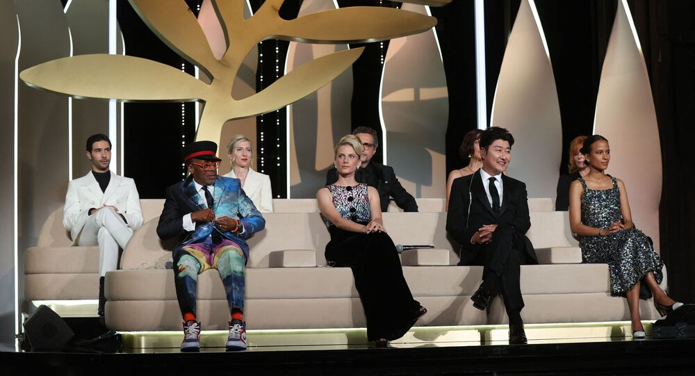 (Front L to R) US director and Jury President of the 74th Cannes Film Festival Spike Lee, and jury members, French actress and director Melanie Laurent, South Korean actor Song Kang-Ho, French-Senegalese director Mati Diop and (back L to R) French actor Tahar Rahim, Austrian director Jessica Hausner, Brazilian director Kleber Mendonca Filho, US actress Maggie Gyllenhaal and French-Canadian singer Mylene Farmer attend the closing ceremony of the 74th edition of the Cannes Film Festival in Cannes, southern France, on July 17, 2021. (Photo by Valery HACHE / AFP)