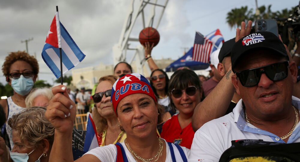 A woman holds a Cuban flag during a rally in solidarity with protesters in Cuba, in Little Havana neighborhood in Miami, Florida, U.S. July 14, 2021.