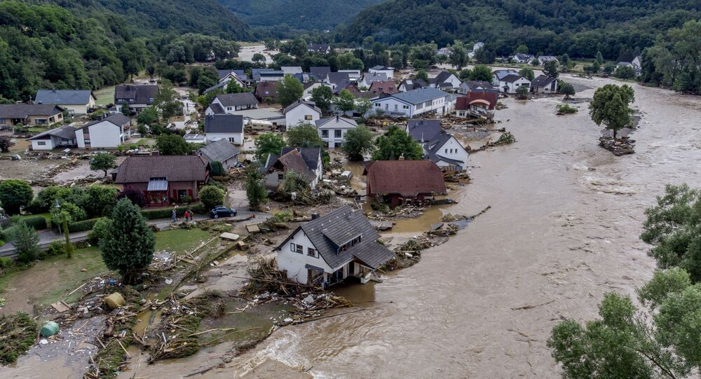 Damaged houses are seen at the Ahr river in Insul, western Germany, Thursday, July 15, 2021. Due to heavy rain falls the Ahr river dramatically went over the banks the evening before. People have died and dozens of people are missing in Germany after heavy flooding turned streams and streets into raging torrents, sweeping away cars and causing some buildings to collapse.