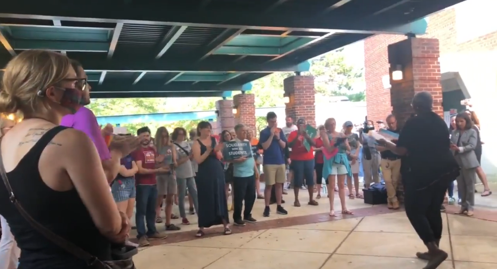 Screenshot from a video allegedly showing Michelle Leete, an ex-vice president of training at Virginia's Parent-Teacher Association, protesting before the Fairfax Schools board, saying that opponents of critical race theory can die