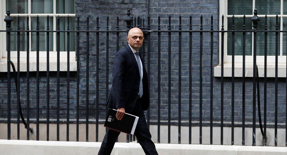 Britain's Health Secretary Sajid Javid walks on Downing Street in London, Britain, July 14, 2021