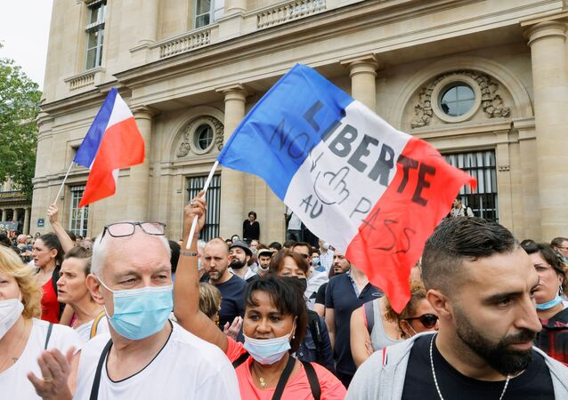 Demonstrators attend a protest against the new measures announced by French President Emmanuel Macron to fight the coronavirus disease (COVID-19) outbreak, in Paris, France, July 17, 2021.