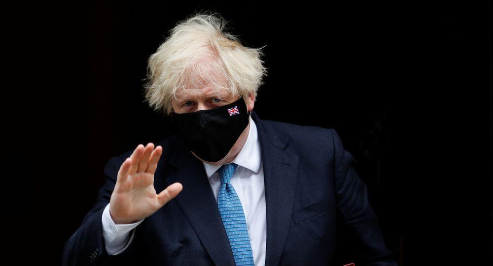 Britain's Prime Minister Boris Johnson walks on Downing Street in London, Britain, 14 July 2021