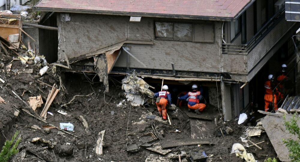 Rescue and search operation continues at the site of a mudslide which was caused by heavy rain at Izusan district in Atami, Japan