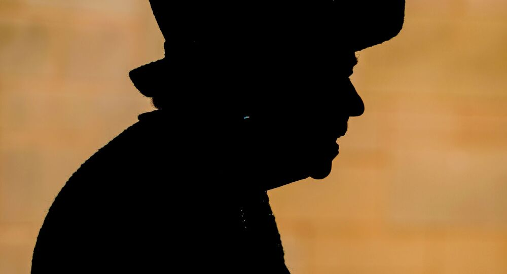 Britain's Queen Elizabeth is seen in silhouette as she visits Manchester Cathedral, in Manchester, Britain, July 8, 2021