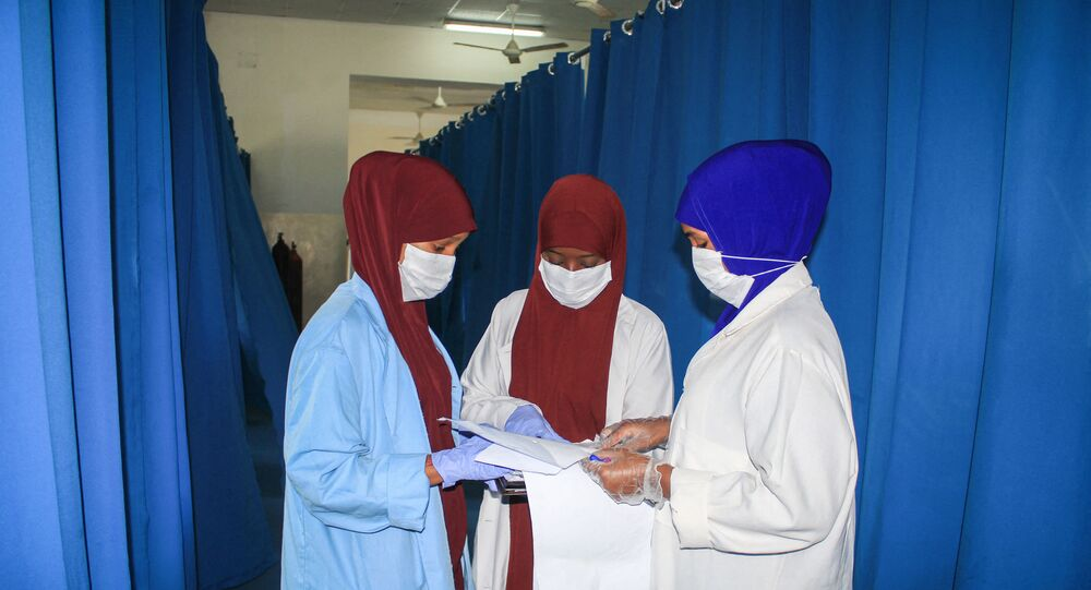 Nurses work for patients who are infected with the COVID-19 coronavirus in the recovery ward at Martini hospital in Mogadishu, Somalia, on July 29, 2020.