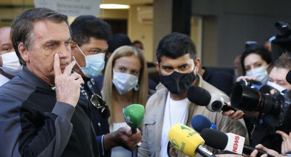 Brazilian President Jair Bolsonaro speaks during a press conference at the Vila Nova Star Hospital in Sao Paulo, Brazil, on July 18, 2021.