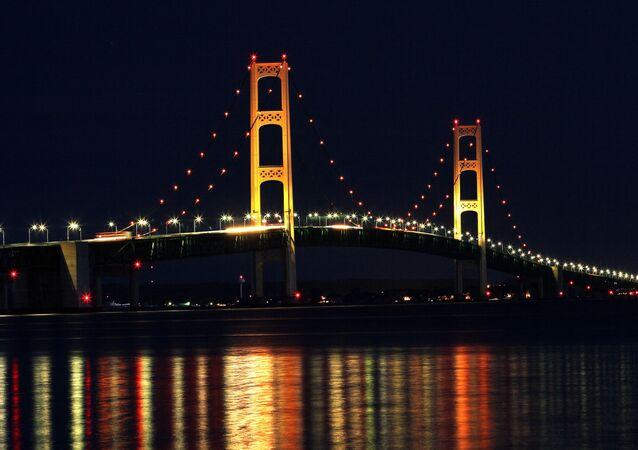 The Mackinaw Bridge July 27, 2008 as seen from St. Ignace, MI.The Mackinac Bridge straddles the Straits of Mackinac connecting Michigan's upper and lower peninsulas. Building it took three years, 2,500 men, 85,000 blueprints, 71,300 tons of structural steel, 466,3000 cubic yards of concrete, 41,000 miles of cable wire and millions of steel rivets and bolts.
