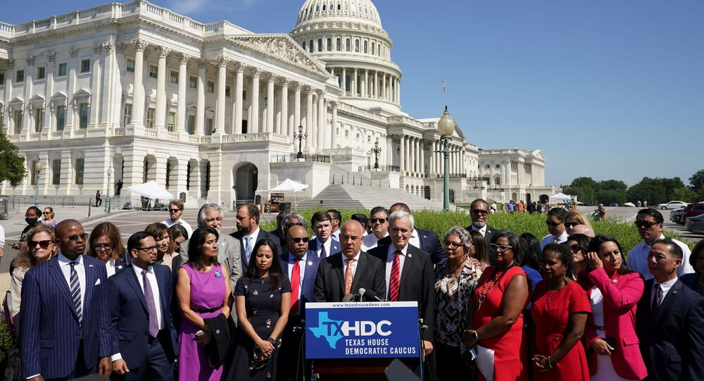 Representative Chris Turner (D-TX) joins other Democratic members of the Texas House of Representatives, who are boycotting a special session of the legislature in an effort to block Republican-backed voting restrictions, as they speak in front of the U.S. Capitol in Washington, U.S., July 13, 2021