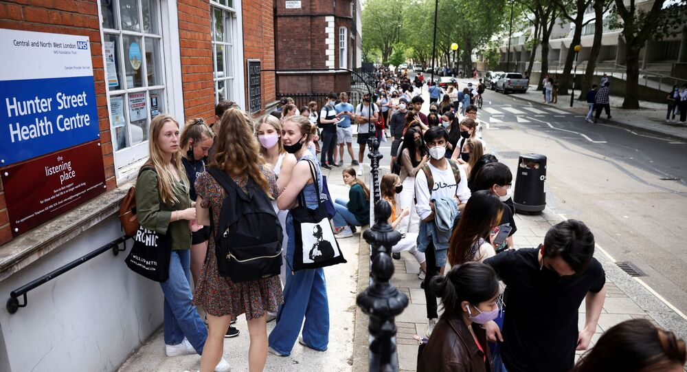 People queue outside a vaccination centre for young people and students at the Hunter Street Health Centre, amid the coronavirus disease (COVID-19) outbreak, in London, Britain, June 5, 2021