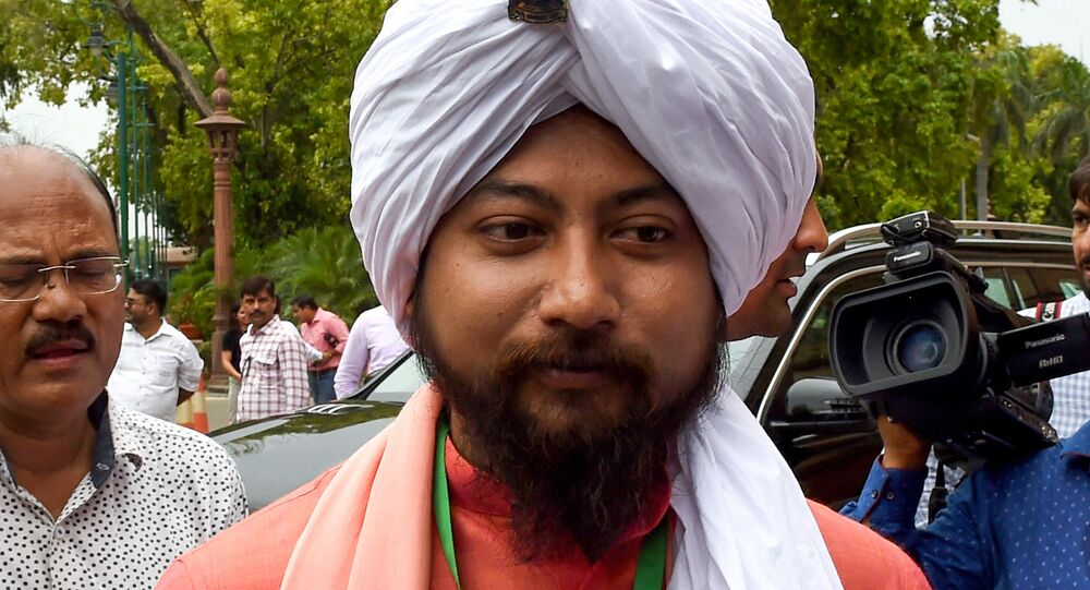 Newly elected Member of Parliament, Nisith Pramanik, looks on as he arrives to attend the first session of the Indian parliament in New Delhi on June 17, 2019
