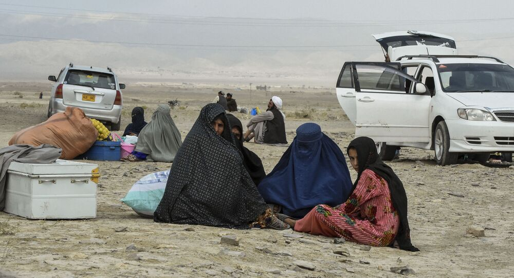 Stranded people wait for the reopening of border crossing point in Pakistan's border town of Chaman on July 16, 2021, following clashes between Afghan forces and Taliban fighters in Spin Boldak to retake the key border crossing with Pakistan.