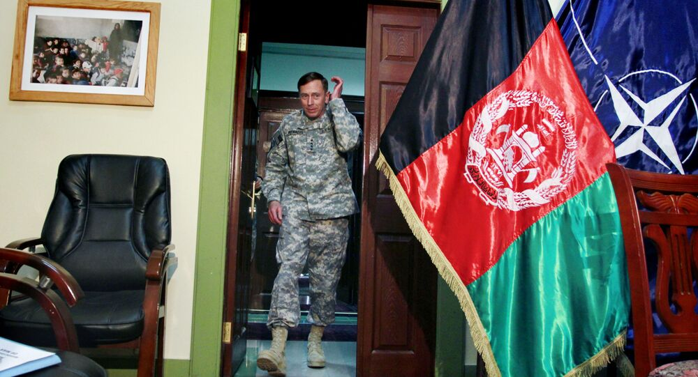 In this Wednesday, March 9, 2011 file photo, Gen. David Petraeus, then top commander of U.S. and NATO forces in Afghanistan, arrives for an interview at the NATO's head quarter in Kabul, Afghanistan.