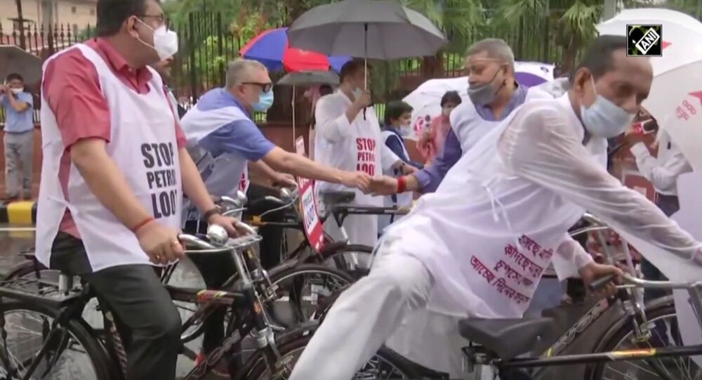 Trinamool Congress MPs cycle to Parliament to protest over fuel price hike