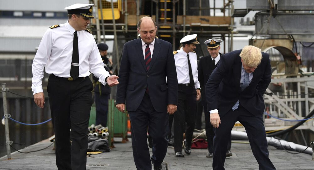 Britain's Prime Minister Boris Johnson, right,  visits HMS Victorious with Defence Secretary Ben Wallace, centre, accompanied by Commander Justin Codd at HM Naval Base Clyde in Faslane, Scotland. File photo.