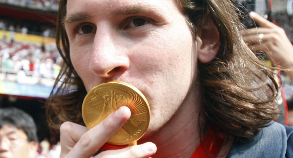 Argentina's Lionel Messi kisses his gold medal after the men's soccer tournament final between Nigeria and Argentina in the National Stadium at the Beijing 2008 Olympics in Beijing, Saturday, Aug. 23, 2008