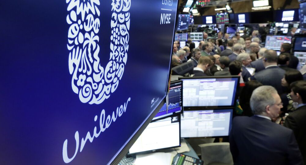 FILE - In this Thursday, March 15, 2018 file photo, the logo for Unilever appears above a trading post on the floor of the New York Stock Exchange. Consumer products giant Unilever, said Thursday July 23, 2020, that second-quarter sales were only slightly lower than the same period a year ago despite the lockdown measures triggered by the global fight against the coronavirus.