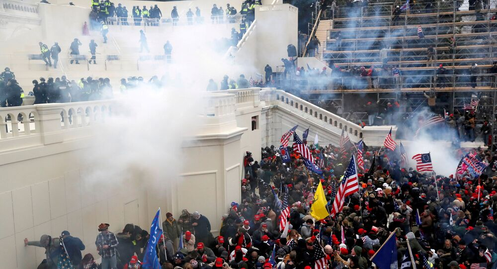 Police release tear gas into a crowd of pro-Trump protesters during clashes at a rally to contest the certification of the 2020 U.S. presidential election results by the U.S. Congress, at the U.S. Capitol Building in Washington, U.S, January 6, 2021.