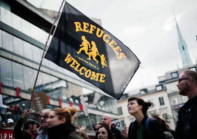 People take part in a demonstration in solidarity with migrants seeking asylum in Europe after fleeing their home countries in Stockholm on September 12, 2015.