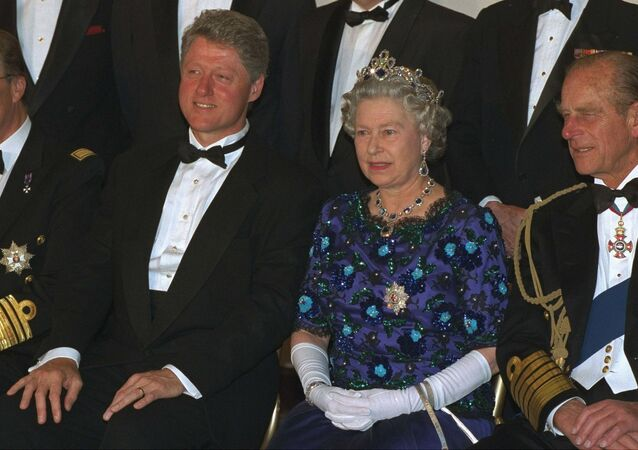 President Bill Clinton joins Britain's Queen Elizabeth and her husband Prince Philip, during a formal photo session for the leaders of Allied nations who took part in D-Day, in Portsmouth Saturday June 4, 1994.